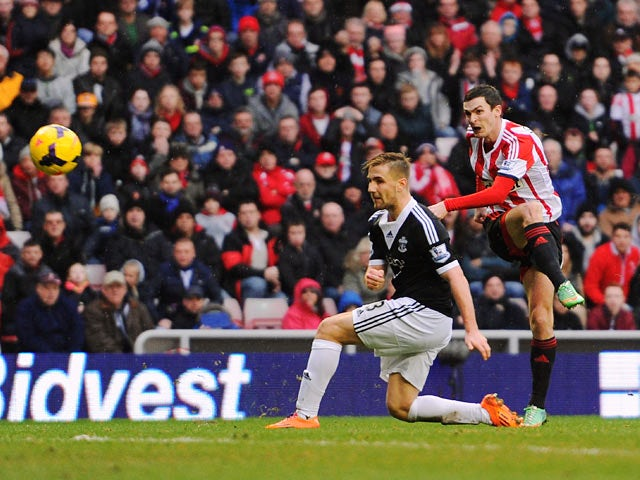Sunderland's Adam Johnson scores his team's second goal against Southampton during their Premier League match on January 18, 2014