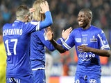 Bastia's Mauritanian midfielder Adama Ba is congratulated by teammates after scoring during the French L1 football match against Bordeaux on January 18, 2014
