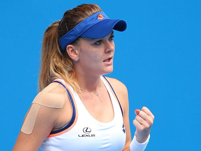 Agnieszka Radwanska celebrates after winning a point against Anastasia Pavlyuchenkova during their Australian Open third round match on January 18, 2014