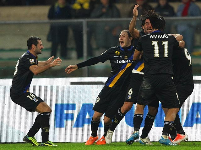 Parma's Alessandro Lucarelli celebrates with teammates after scoring his team's second goal against Chievo Verona during their Serie A match on January 19, 2014
