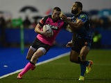 Cardiff Blues' Alex Cuthbert is tackled by Exeter's Fetu,u Vainikolo during their Heineken Cup match on January 18, 2014