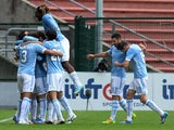 Lazio's Anderson Hernanes is mobbed by teammates after scoring his team's third goal against Udinese during their Serie A match on January 19, 2014