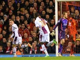 Aston Villa's Austrian striker Andreas Weimann turns to celebrate scoring the opening goal as Liverpool players react during the English Premier League football match on January 18, 2014