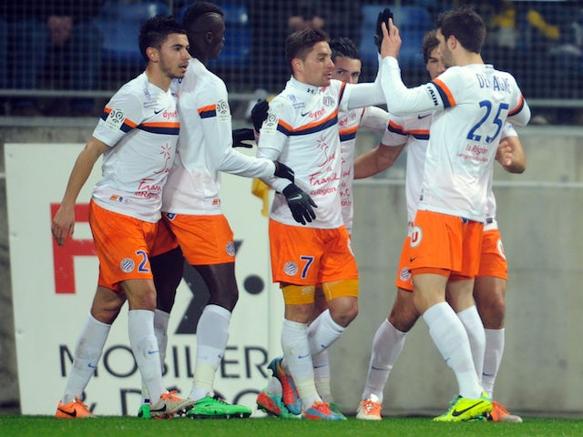 Montpellier's French forward Anthony Mounier is congratulated by his teammates after scoring a goal during the French L1 football match against Sochaux on January 18, 2014