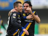 Parma's Antonio Cassano celebrates with teammate Alessandro Lucarelli after scoring his team's first goal against Chievo Verona during their Serie A match on January 19, 2014