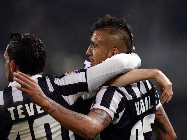 Arturo Vidal of Juventus (R) celebrates scoring the first goal during the Serie A match between Juventus and UC Sampdoria at Juventus Arena on January 18, 2014