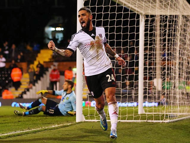 Fulham's Ashkan Dejagah celebrates after scoring his team's second goal against Norwich during their FA Cup third round replay match on January 14, 2014