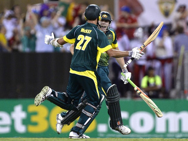 James Faulkner and Clint McKay of Australia celebrate victory after the second game of the One Day International Series between Australia and England at The Gabba on January 17, 2014