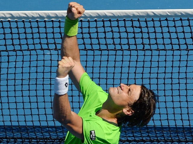 Spain's David Ferrer celebrates after victory in his men's singles match against France's Jeremy Chardy on day five of the 2014 Australian Open tennis tournament in Melbourne on January 17, 2014