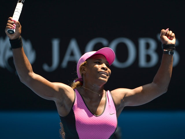 Serena Williams of the US celebrates after victory in her women's singles match against Slovakia's Daniela Hantuchova on day five of the 2014 Australian Open tennis tournament in Melbourne on January 17, 2014
