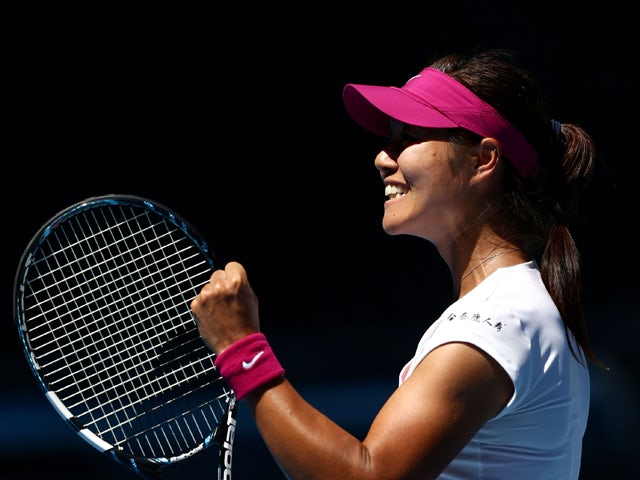 Li Na of China celebrates winning her third round match against Lucie Safarova of the Czech Republic during day five of the 2014 Australian Open at Melbourne Park on January 17, 2014