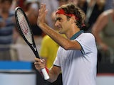 Switzerland's Roger Federer acknowledges fans after his victory against Slovenia's Blaz Kavcic during their men's singles match on day four of the 2014 Australian Open tennis tournament in Melbourne on January 16, 2014