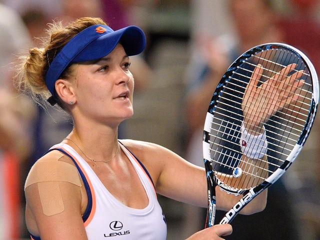 Agnieszka Radwanska of Poland celebrates her victory over Olga Govortsova of Belarus in their women's singles second round match on day four of the 2014 Australian Open tennis tournament in Melbourne on January 16, 2014