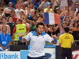 Jo-Wilfried Tsonga of France celebrates his victory over Thomaz Bellucci of Brazil in their men's singles second round match on day four of the 2014 Australian Open tennis tournament in Melbourne on January 16, 2014
