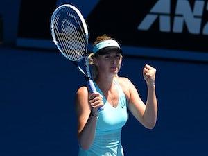 Sharapova withstands heat to progress