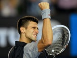 Serbia's Novak Djokovic celebrates after victory in his men's singles match against Uzbekistan's Denis Istomin on day five of the 2014 Australian Open tennis tournament in Melbourne on January 17, 2014