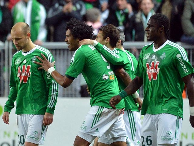 Saint-Etienne's Brandao celebrated with teammates after scoring the opening goal against Lille during their Ligue 1 match on January 17, 2014