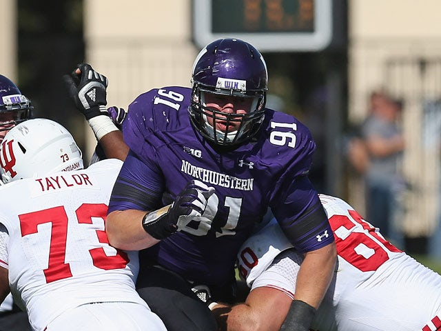 Brian Arnfelt #91 of the Northwestern Wildcats in action against Indiana Hoosiers on September 29, 2012