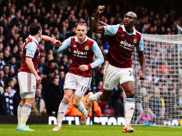 Carlton Cole of West Ham United and team mates celebrate as Newcastle United concede an own goal by Mike Williamson during the Barclays Premier League match on January 18, 2014