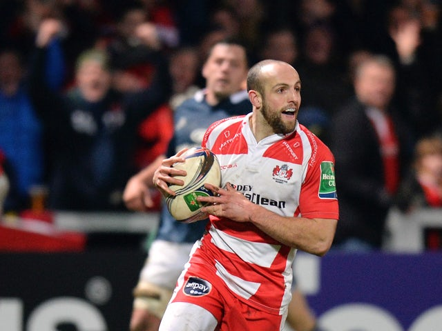Charlie Sharples of Gloucester runs in to score their first try during the Heineken Cup Pool Six match between Gloucester and Munster at Kingsholm Stadium on January 11, 2014