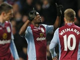 Belgian striker Christian Benteke celebrates after scoring his team's first goal during an English Premier League football match between Aston Villa and Arsenal on January 13, 2014