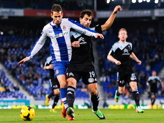 Christian Stuani duels for the ball with Jonny Castro of RC Celta de Vigo of RCD Espanyol during the La Liga match between RCD Espanyol and RC Celta de Vigo on January 18, 2014