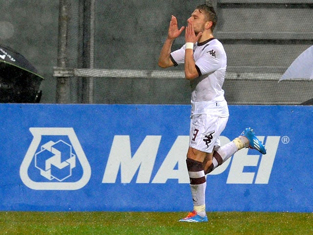 Torino's Ciro Immobile celebrates after scoring the opening goal against Sassuolo during their Serie A match on January 19, 2014