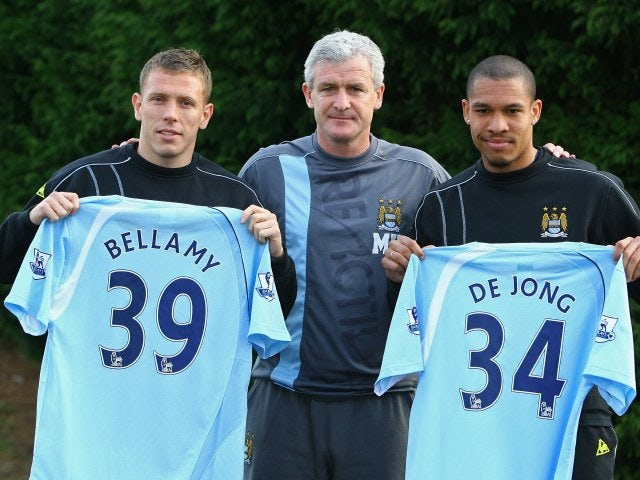 Mark Hughes, then manager of Manchester City, unveils his new signings Craig Bellamy and Nigel de Jong on January 19, 2009.