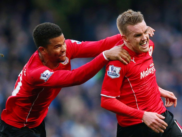 Craig Noone of Cardiff is congratulated by teammate Fraizer Campbell after scoring a goal to level the scores at 1-1 during the Barclays Premier League