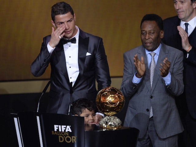 Cristiano Ronaldo wells up on stage after being awarded FIFA's Ballon d'Or prize in Zurich on January 13, 2014