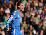 Real's Cristiano Ronaldo celebrates after scoring the opening goal against Real Betis during their La Liga match on January 18, 2014