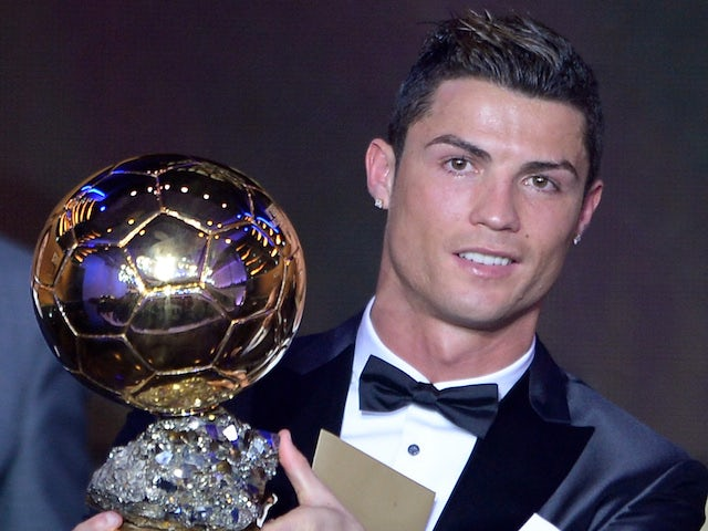 Real Madrid's Portuguese forward Cristiano Ronaldo poses with the 2013 FIFA Ballon d'Or award for player of the year during the FIFA Ballon d'Or award ceremony on January 13, 2014