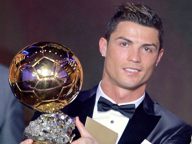Real Madrid's Portuguese forward Cristiano Ronaldo poses with the 2013 FIFA Ballon d'Or award for player of the year during the FIFA Ballon d'Or award ceremony on January 13, 2014