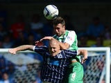 Nicky Bailey of Millwall contests the ball with Dan Seaborne of Yeovil during the Sky Bet Championship match between Millwall and Yeovil Town at The Den on August 03, 2013