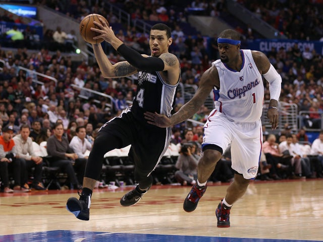 Danny Green #4 of the San Antonio Spurs drives past Stephen Jackson #1 of the Los Angeles Clippers to the basket in the second half at Staples Center on December 16, 2013