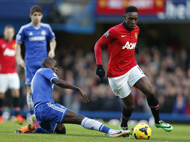Chelsea's Ramires tries to tackle Man United's Danny Welbeck during their Premier League match on January 19, 2014