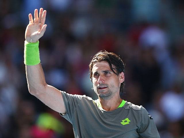 David Ferrer celebrates after his win over Florian Mayer in their Australian Open fourth round match on January 19, 2014
