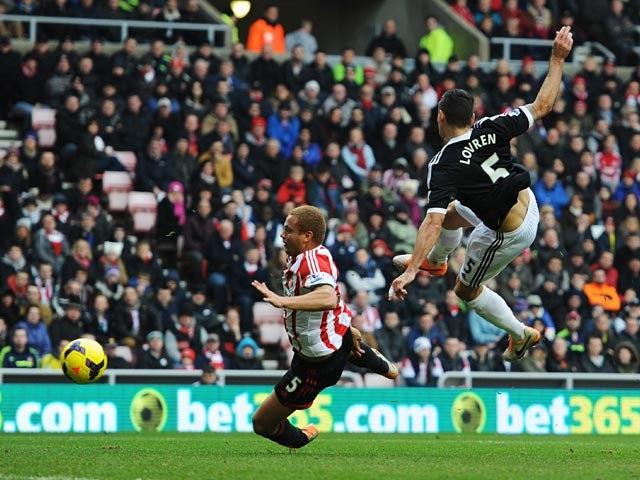 Southampton's Dejan Lovren scores his team's second goal against Sunderland during their Premier League match on January 18, 2014