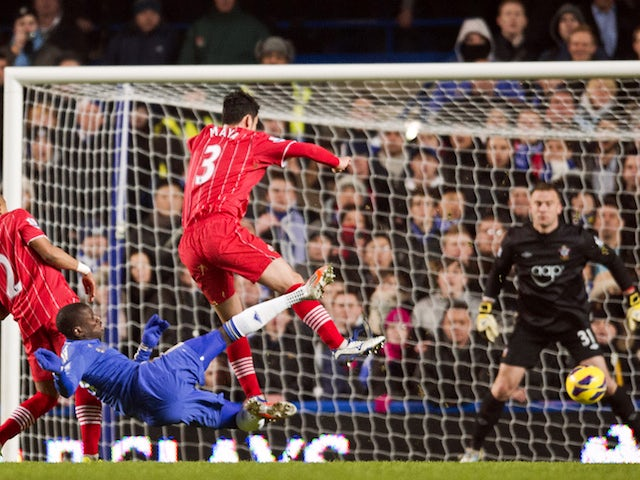 Chelsea's French-born Senegalese striker Demba Ba (2nd L) shoots and scores the opening goal of the English Premier League football match between Chelsea and Southampton on January 16, 2013