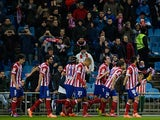 Atletico Madrid's Diego Godin celebrates with teammates after scoring the opening goal against Valencia during their Copa del Rey match on January 14, 2014