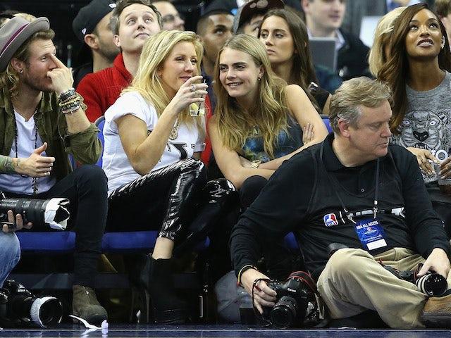 Dougie Poynter, Ellie Goulding, Cara Delevingne and Jourdan Dunn enjoy NBA London at the O2 Arena on January 16, 2014
