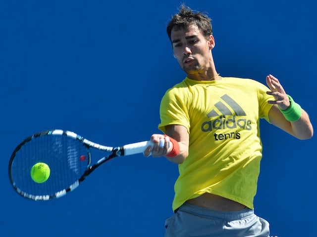 Italy's Fabio Fognini plays a shot during a practice session ahead of the 2014 Australian Open tennis tournament in Melbourne on January 11, 2014