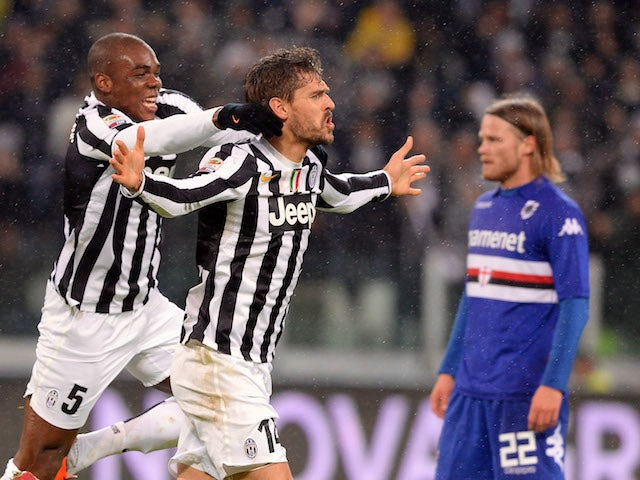 Fernando Llorente of Juventus celebrates after scoring the second goal with his teammate Angelo Ogbonna #5 during the Serie A match against UC Sampdoria on January 18, 2014
