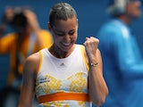 Flavia Pennetta celebrates after her win over Angelique Kerber in their Australian Open fourth round match on January 19, 2014