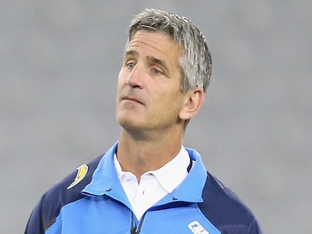 Quarterbacks Coach Frank Reich of the San Diego Chargers talks with quarterback Philip Rivers (L) efore the preseason NFL game against the Arizona Cardinals on August 26, 2014