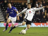 Carlos Bocanegra of Fulham clears the ball from Matty Fryatt of Leicester City during the FA Cup sponsored by E.ON 3rd Round replay match between Fulham and Leicester City at Craven Cottage on January 17, 2007
