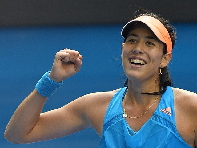 Garbine Muguruza celebrates victory over Caroline Wozniacki during their Australian Open third round match on January 18, 2014