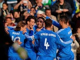 Real's Gareth Bale is congratulated by teammates after scoring his team's second goal via the penalty spot against Real Betis during their La Liga match on January 18, 2014