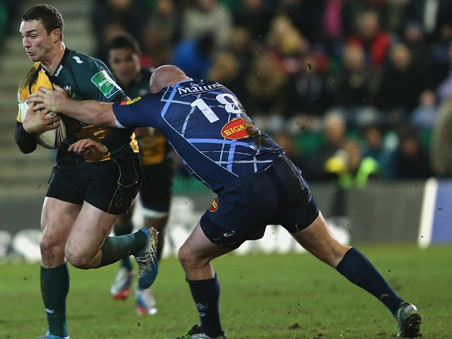 Northampton Saints' George North tangles with Castres' Mihaita Lazar during their Heineken Cup match on January 17, 2014