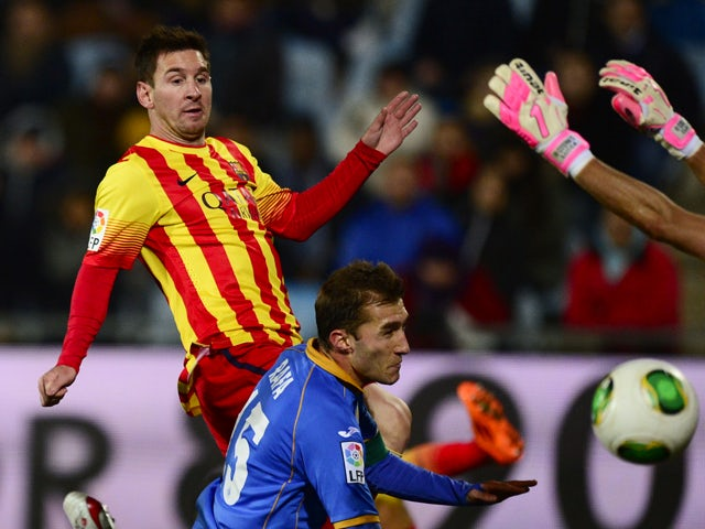 Barcelona's Argentinian forward Lionel Messi shoots to score in front of Getafe's defender Rafael Lopez during the Spanish Copa del Rey (King's Cup) round of 16 second-leg football match Getafe CF vs FC Barcelona at the Coliseum Alfonso Perez stadium in G